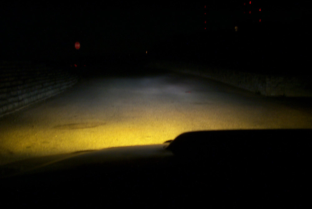 Headlights and fogs, projected on a different road