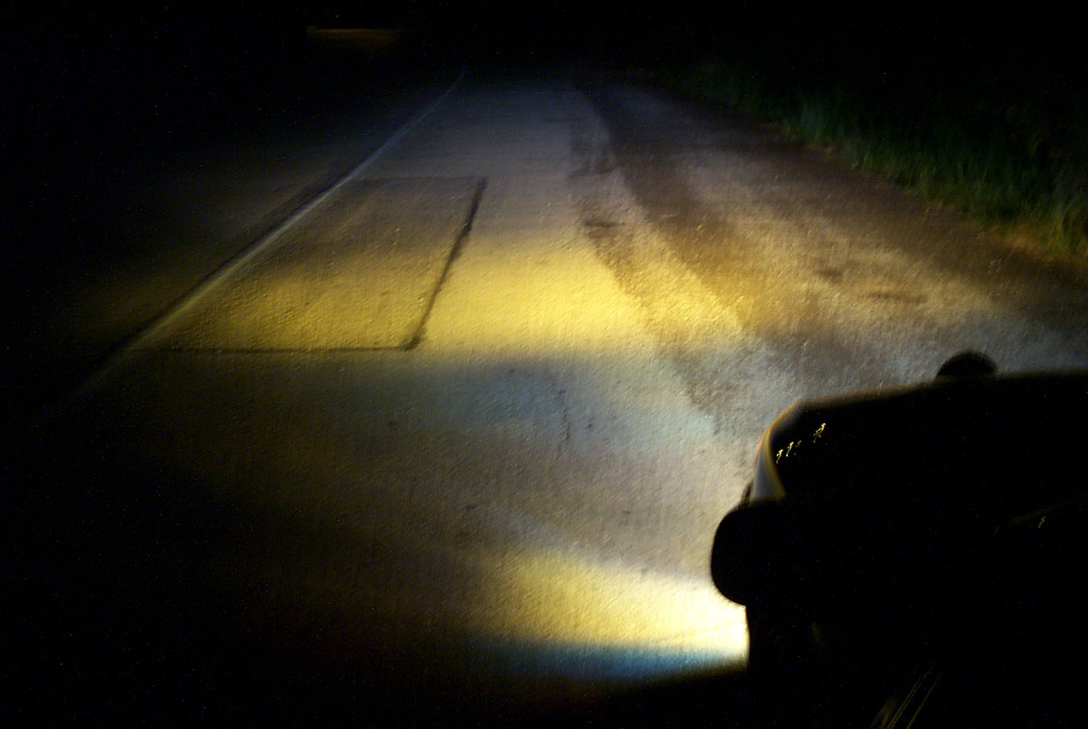 Another headlights and Foglights , projected on the road.